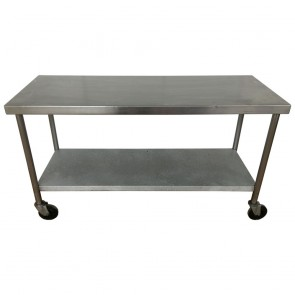 Used Stainless steel table and shelf unit on wheels