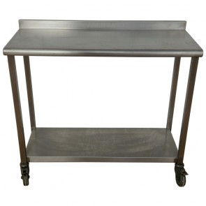 Used Stainless steel table and shelf on wheels